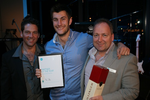 Guy Pearson (centre) collecting his award with Xero's Rod Drury (right)