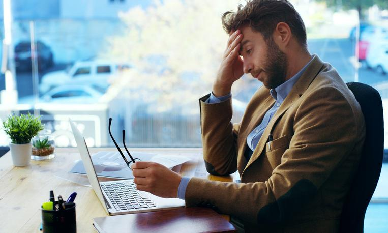 Man looking at his website stressed