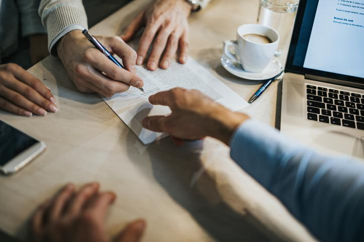 Client signing a contract at their accountants