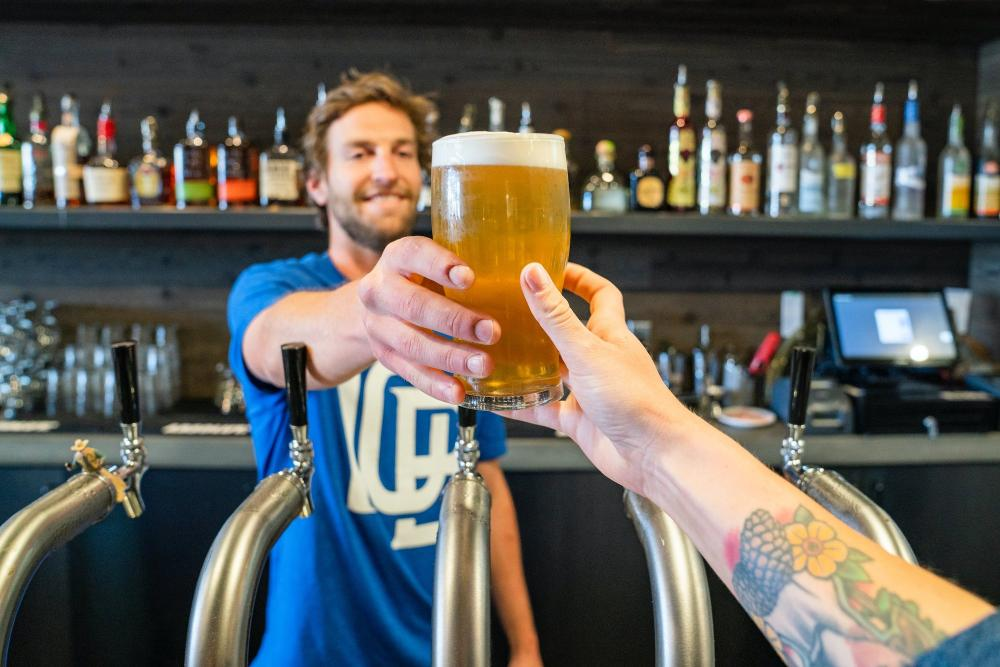 man-handing-a-person-a-glass-of-beer-1267323.jpg