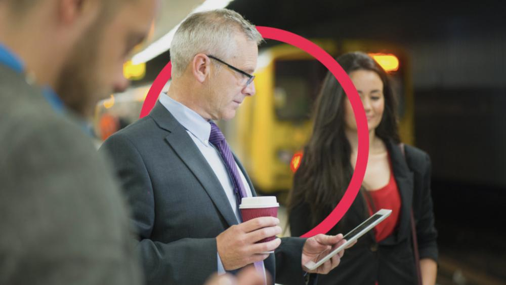 Man in suit looking at smart phone