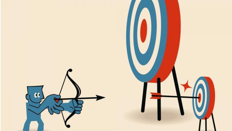 Businessman aiming at smaller target