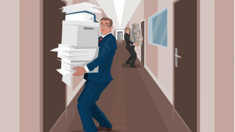Employees carry documents between offices