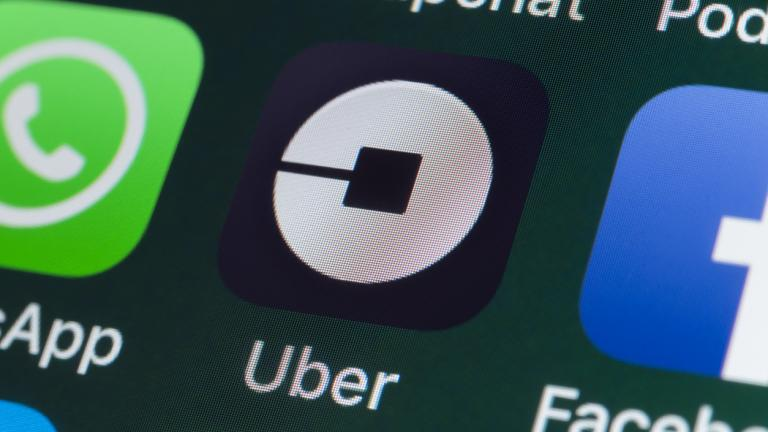 he buttons of the taxi App Uber, surrounded by WhatsApp, Facebook, Snapchat and other apps on the screen of an iPhone.