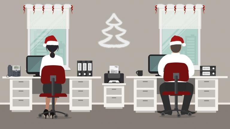 Office workers in Santa hats in the workplace