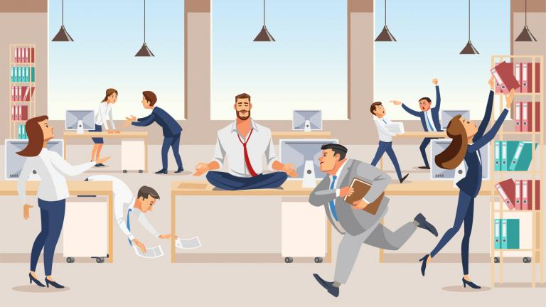 Office worker meditating at workplace