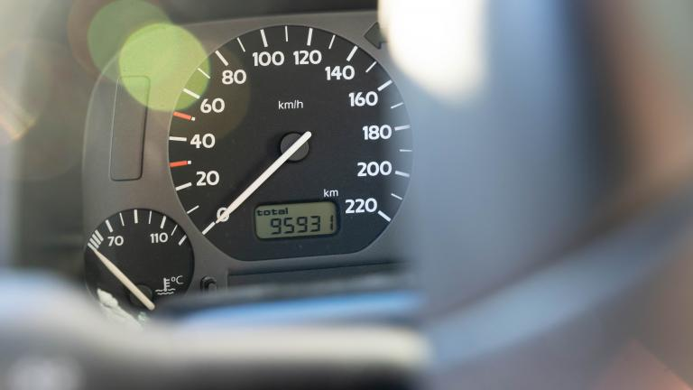 Tachometer of a car seen through a steering wheel