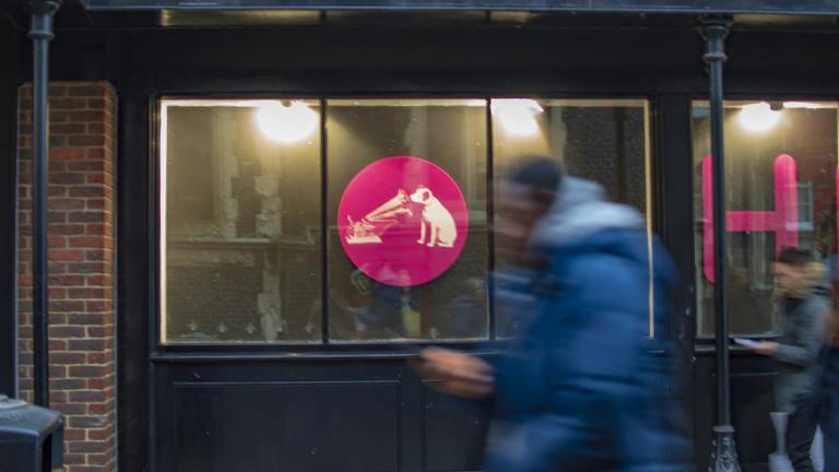 A man passes past HMV store