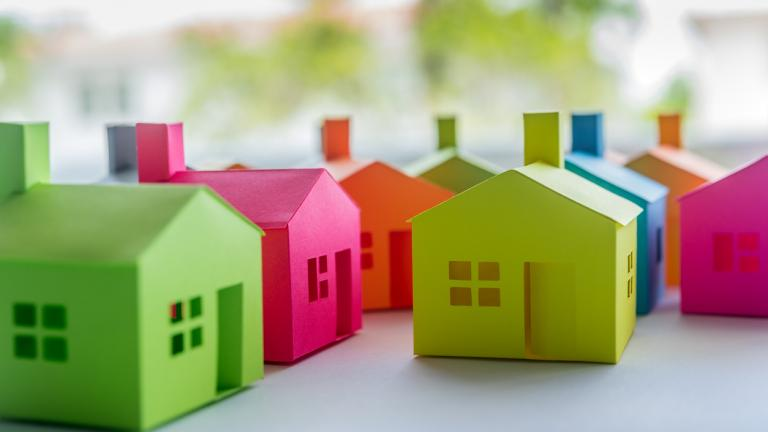 Group of multicolored houses on sale