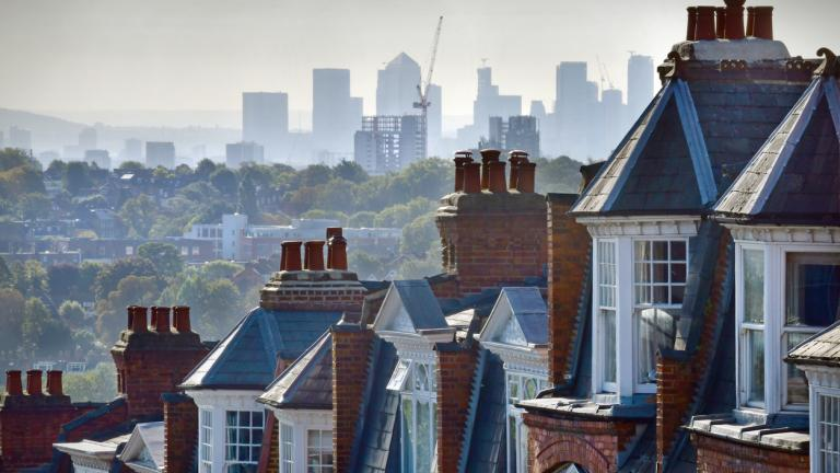 The London suburb of Muswell Hill. Rooftops of Victorian homes and street with view across London to the offices and workplaces of Canary Wharf