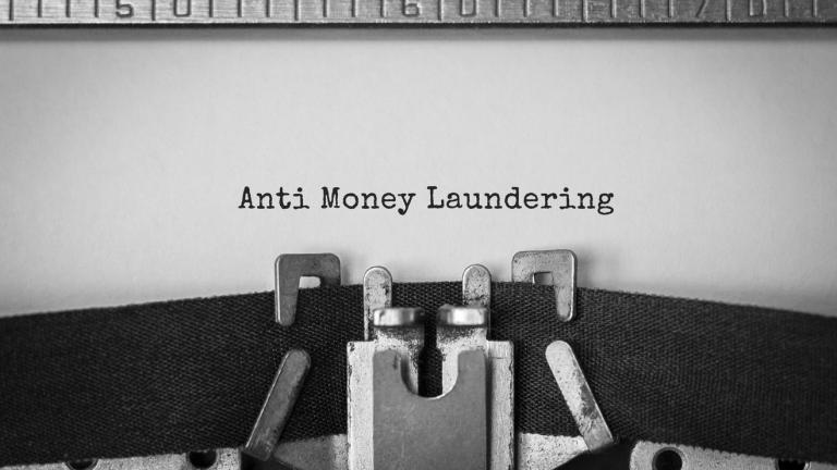 Text Anti Money Laundering typed on retro typewriter