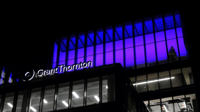 The Grant Thornton office building lit up at night in City Quay, Dublin, at Christmas time.
