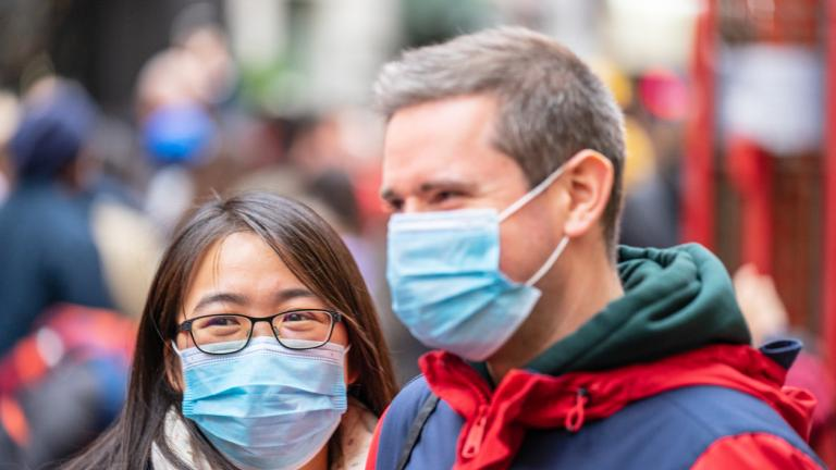 People wearing a face masks to protecting themself