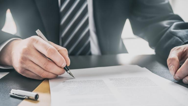 Business man signing a document