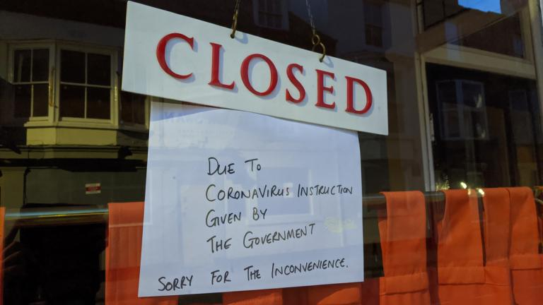 Closure sign hung in restaurant window due to Corona virus