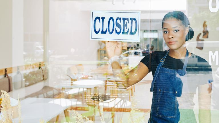 Sad young small business owner has to close her cafe due economic crisis.