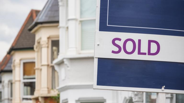 Sold sign displayed outside a terraced house in Harringay Ladder area, London