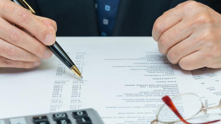 CFO reviewing financial reports