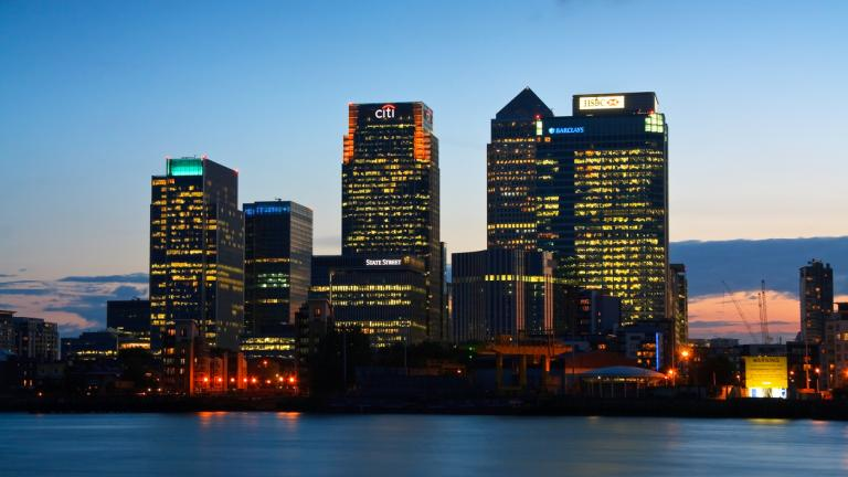 Looking towards Canary Wharf from North Greenwich over river Thames.