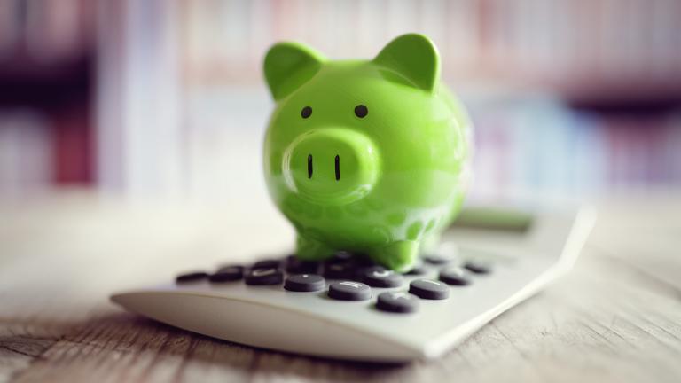 Piggy bank with a calculator