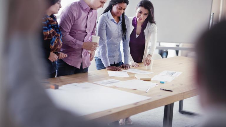 Group of designers collaborating in office studio