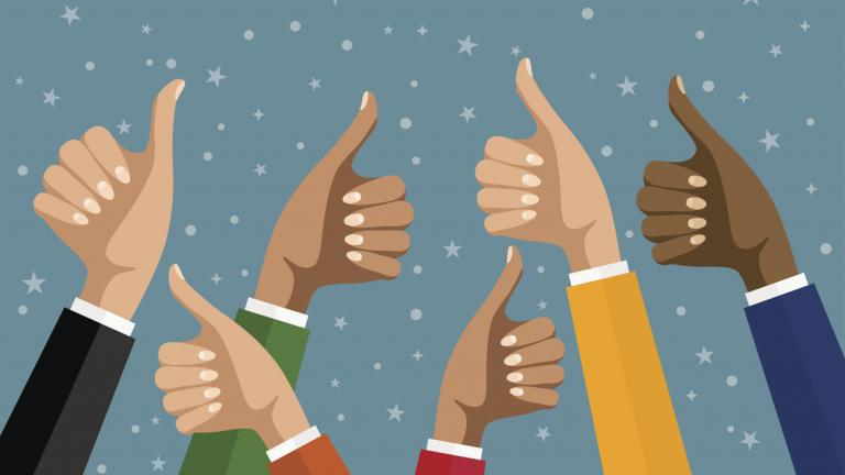 Businesswomen hands hold thumbs up