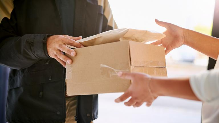 A courier making a delivery to a customer
