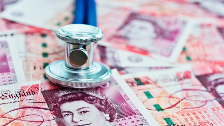Stethoscope on top of British fifty pound note
