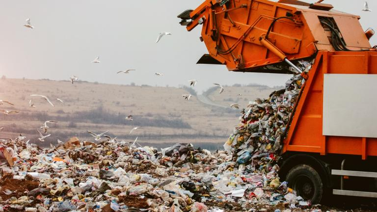 Garbage truck dumping the garbage