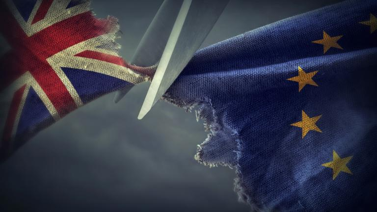UK and EU flags being cut