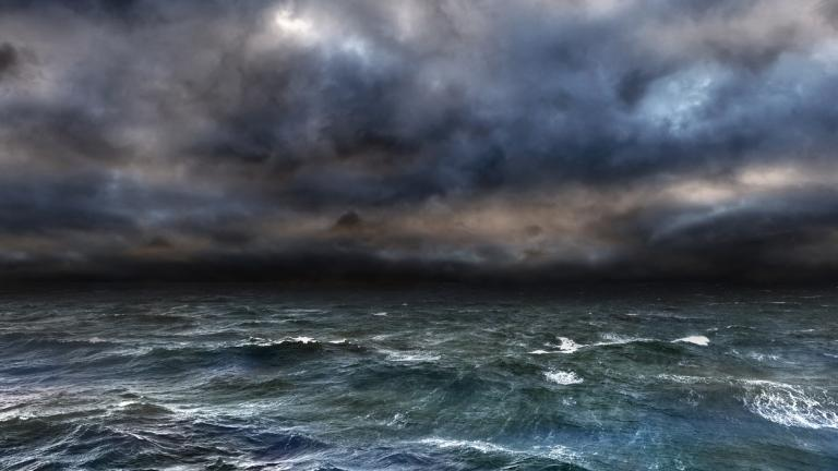 a stormy sky above a raging sea