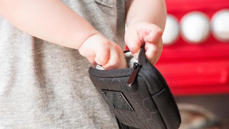 Child taking money from a wallet
