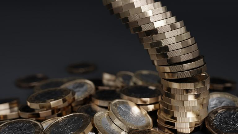 Falling stack of British one pound coins