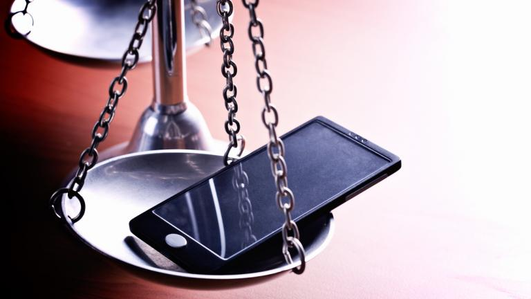 mobile phone on the scales of justice