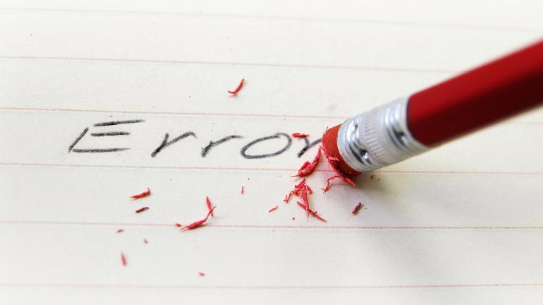 Pencil eraser correcting a spelling error