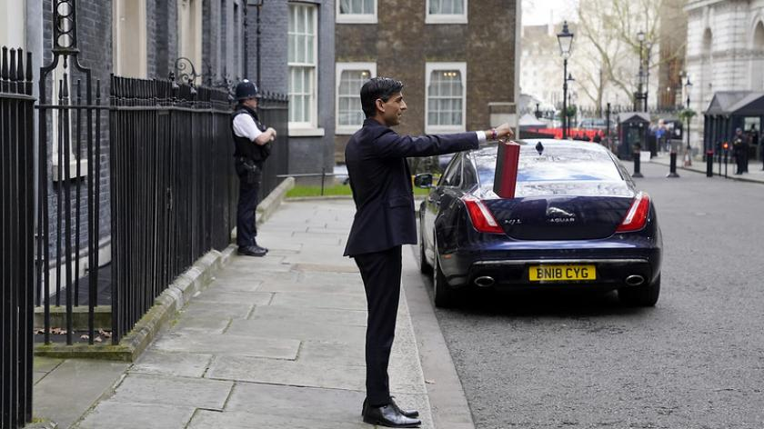 Chancellor of the Exchequer Rishi Sunak holds up the red box outside Number 11 on his first Budget. Picture by Andrew Parsons / No 10 Downing Street