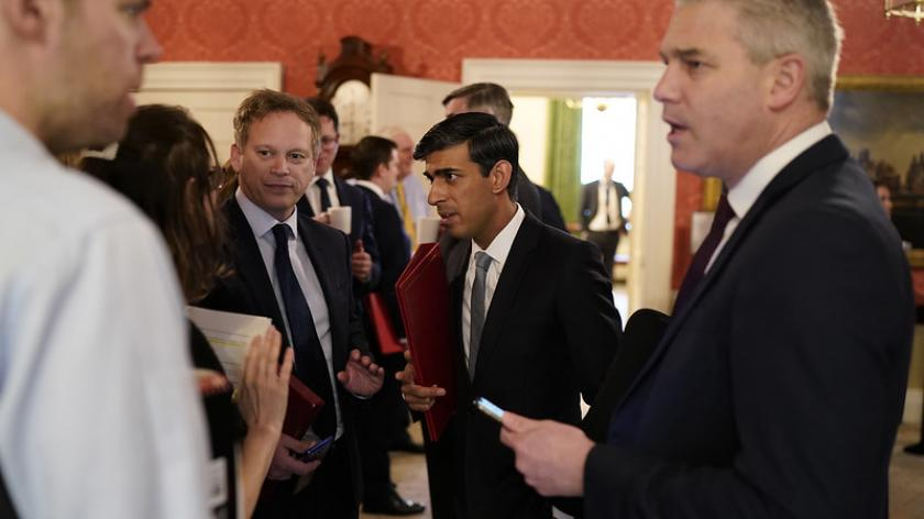 Chancellor of the Exchequer Rishi Sunak (middle) with Stephen Barclay Chief Secretary to the Treasury (right) are briefed outside the cabinet room