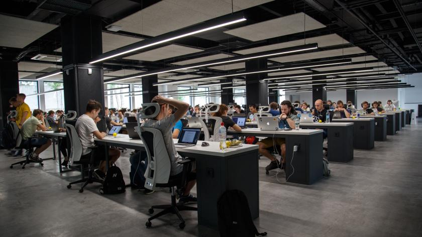 People in a modern office using computers to share information