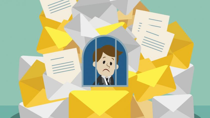 Businessman stuck in the email trap