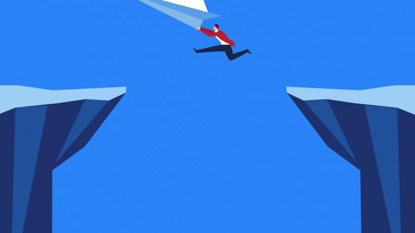 Paper plane with businessman flying over the cliff