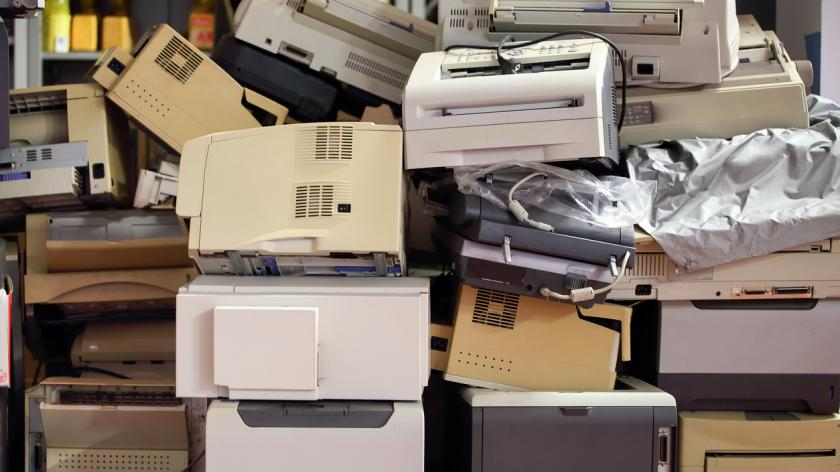 Printers: old monitors, computers, copy machines, and other office supplies in the waste