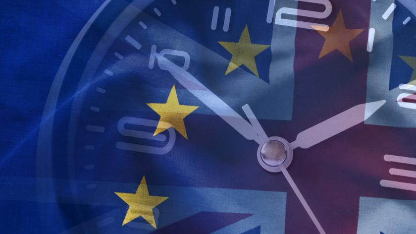 Composite of the EU and British flags with a clock