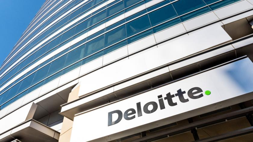 Image of Deloitte logo above the entrance of their office