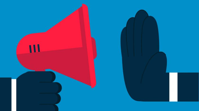 A huge hand prevents the loudspeaker from speaking