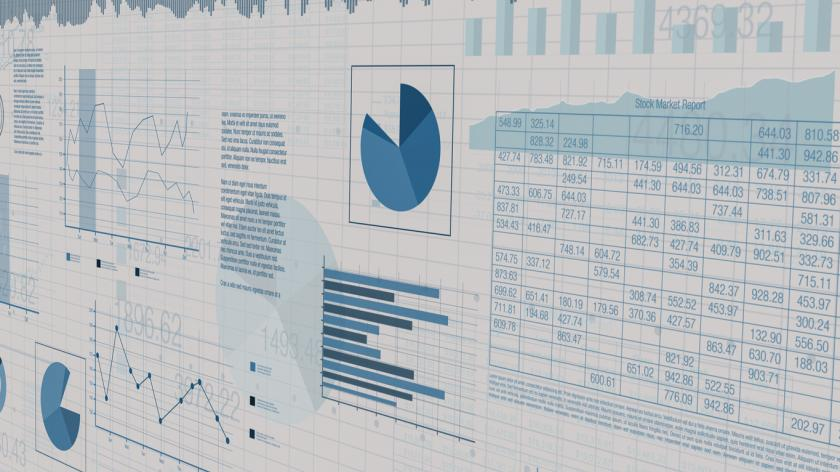 Sheets with numbers and financial charts