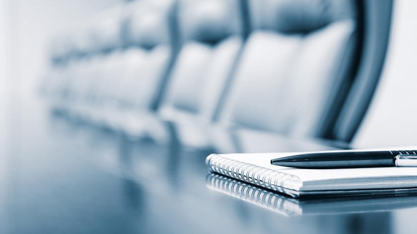 company director; notepad in a boardroom