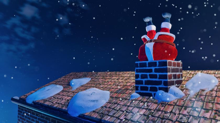 Christmas image: Santa Claus gets stuck in chimney on christmas eve