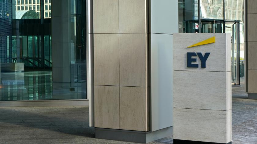 Blue and yellow EY signage at entrance to their office in Canary Wharf