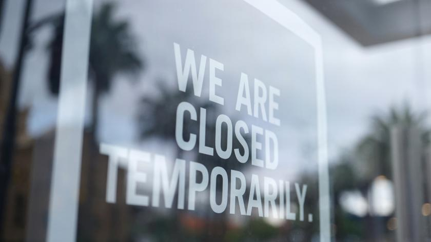 A picture of a 'temporary closed' sign
