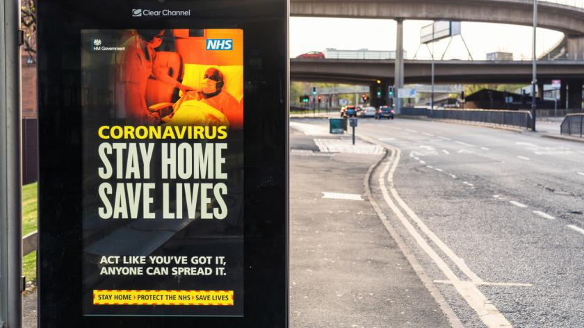 A government message on a digital bus stop screen, advising people to stay at home during the the coronavirus pandemic lockdown.